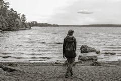 Girl on the shore of a lake Stock Photos