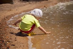 Girl on the shore Royalty Free Stock Photo