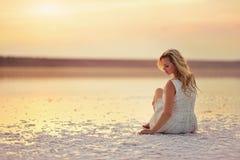 Girl on the shore of the salt stock photo