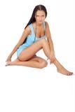 Girl in short blue dress Stock Images