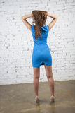 Girl in short blue dress from beck Royalty Free Stock Image
