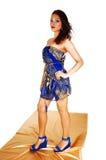 Girl in short blue dress. Royalty Free Stock Photo