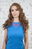 Girl in short blue dress with violet necklace Royalty Free Stock Photography