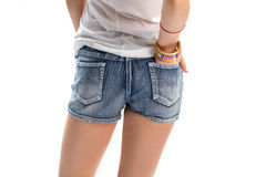 Girl in short denim shorts. Stock Photography