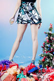 Girl in short dress at party. Young woman in short dress with wine glass at Christmas party Stock Photography