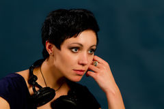 Girl with short hair with headphones Royalty Free Stock Images