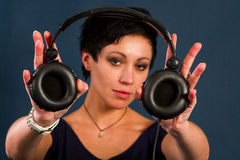 Girl with short hair with headphones Stock Photography