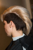 The girl with short haircut in the barber shop close-up Royalty Free Stock Image