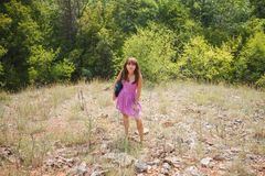 A girl in a short pink dress in a sunny Crimea stock image