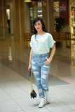 Girl in short shert the mall Royalty Free Stock Photo