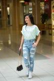 Girl in short shert the mall Stock Image