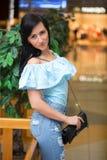 Girl in short shert the mall Stock Images