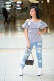 Girl in short shert the mall Royalty Free Stock Photo