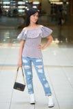 Girl in short shert the mall Stock Photos