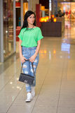 Girl in short shert the mall Royalty Free Stock Image
