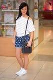 Girl in short shert the mall Stock Photography