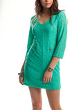Girl in short turquoise dress. Royalty Free Stock Photography