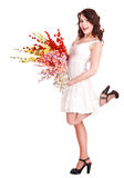 Girl in short white dress with spring flower. Royalty Free Stock Photography