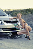 Girl washing car Royalty Free Stock Image