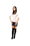 A girl in shorts and boots. Royalty Free Stock Photo