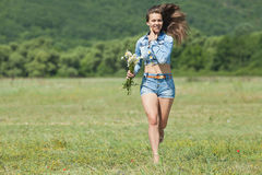 Girl in shorts in field stock images