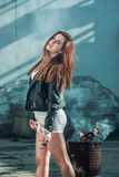 Girl in shorts and a leather jacket. Posing Royalty Free Stock Photos