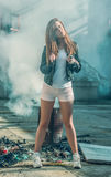 Girl in shorts and a leather jacket. Posing Royalty Free Stock Images