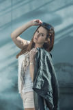 Girl in shorts and a leather jacket. Posing Royalty Free Stock Photography