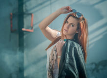Girl in shorts and a leather jacket. Posing Royalty Free Stock Image