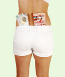Girl in shorts with money. Stock Photos