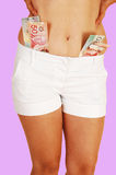 Girl in shorts with money. Stock Image