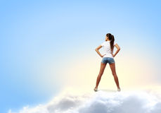 Girl in shorts Stock Images