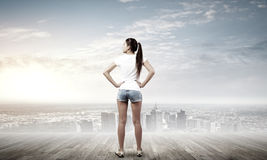 Girl in shorts Stock Photos