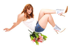 Girl in shorts sitting on floor. A young bright red haired girl, sitting on the floor in the studio for white Stock Photos