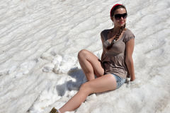girl in shorts in the snow stock photos