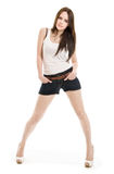 The girl in shorts standing. On a white background Stock Photo