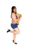 Girl in shorts with straw hat. Royalty Free Stock Photography