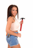 Girl in shorts with tools. Stock Image