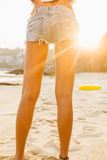 Girl in shorts walk on the beach. royalty free stock image
