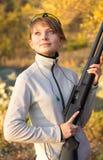 Girl with a shotgun Stock Photo