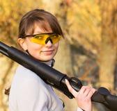 Girl with a shotgun Royalty Free Stock Image