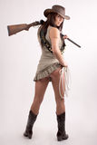 Girl with shotgun. Hat and rope Royalty Free Stock Image