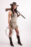 Girl with shotgun. Hat and rope Royalty Free Stock Images