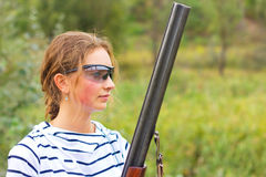 Girl with a shotgun in an outdoor Royalty Free Stock Photography