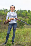Girl with a shotgun in an outdoor Stock Photo