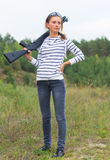 Girl with a shotgun in an outdoor Stock Photography