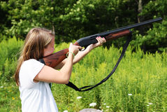 Shooting. Girl shooting skeet out in a field Stock Photos