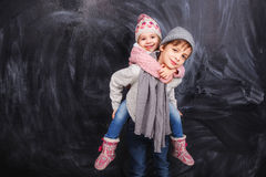 Girl on the shoulders of the boy Royalty Free Stock Images