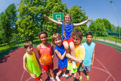 Girl on shoulders of her team after basketball Royalty Free Stock Photos