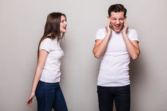 Girl shouting at man. Attractive angry couple fighting. Girl shouting at man Royalty Free Stock Images